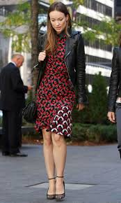 olivia wilde s jacket added tough contrast to her feminine red dress br photo