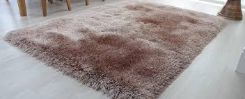 luxurious mink gy rug with glossy pile on the floor