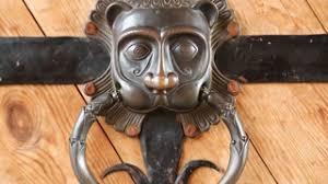 door handle knocker on the old wooden door lion head knocker on a door