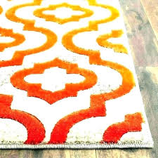 s orange blue green rug and