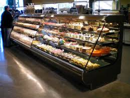 refrigerated display case with shelves illuminated for bakeries shvs
