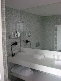 splendid design ideas using grey glass tile backsplash and white quartz countertops also with rectangular mirrors