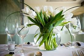view in gallery a vase full of tulips serve as a dining table centerpiece