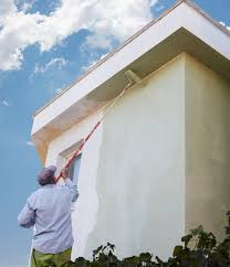 painter paint wall inspector checking incomplete stucco