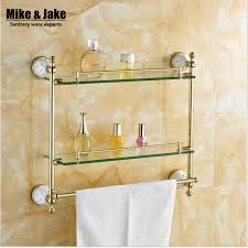 bathroom tempered glass shelf: bathroom accessories solid brass golden finish with tempered glassdouble glass shelf bathroom shelf