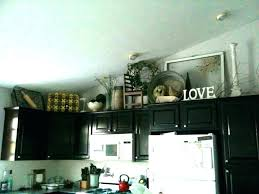top of kitchen cabinet decor above cabinet decor decorate above kitchen cabinets best decorating above kitchen