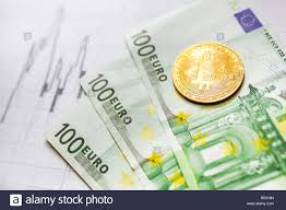 Virtual Money Golden Bitcoin On Hundred Euro Bills And Paper