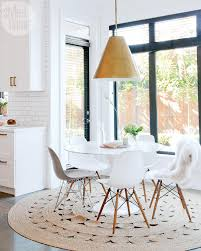 round dining tables look perfect with round or square rugs however rectangular and oval dining tables work better with rectangular rugs