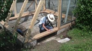 building a greenhouse 4 windows and a door