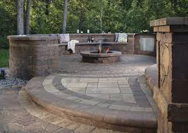 paver patio with fire pit. Products: Weston Stone® (seat Walls, Columns, Kitchen), Lafitt® Rustic Slab (transition, Borders), Bullnose Paver (step), Old World Paver™ (inlaid Patio With Fire Pit