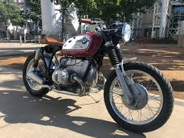 enter duc tran of texas a garage builder and family man whose bmw r65 urban tracker we featured last year as duc says this 1973 bmw r75 5 descended on