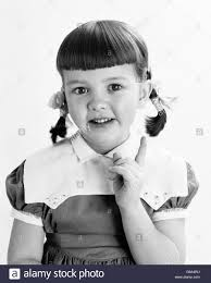 Pigtails Hair Style 1950s portrait smiling girl hair in pigtails pointing finger 8215 by wearticles.com