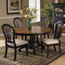 wilshire wood round oval dining table in pine rubbed black