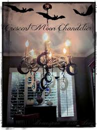 okay so as we said earlier here is what our old brass chandelier used to look like minus the cobwebs bats and crescent moons
