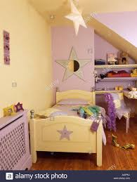 Pale Yellow Bedroom Childs Bedroom With Pastel Yellow And Purple Walls And Pale