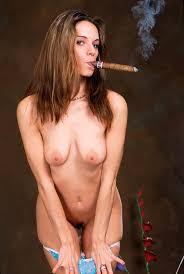 Seductive nude babe smoking a big cigar and spreading her pussy.