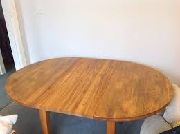 round dining table and 4 chairs solid wood 110cm diameter when extended 160