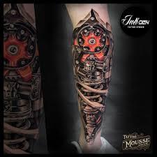 Shamack Bio Leg With Red Inkden Tattoo Studio
