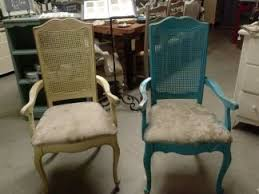 painting cane back dining room chairs. the chairs were really dingy and dirty one of them was painted bright blue. i sold two arm to a loot customer who wanted in painting cane back dining room