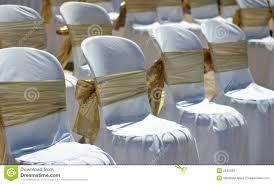 beach wedding chairs. White Chairs With Gold Ribbon At A Beach Wedding