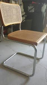 I got these chairs and I plan to restore them. I love the design...I wonder  if these are original ones or replicas. There are not any labels or stamp  in any ...