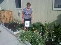 Office gardening Garden Design Woman Standing In Garden Administration For Children And Families Hhsgov Giving Kids Head Start On Healthy Food And Gardening Office Of
