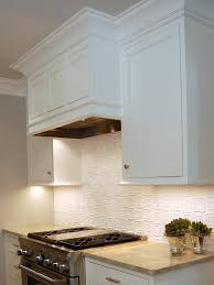 The hidden range hood helps the open kitchen blend easily with the design  of the surrounding