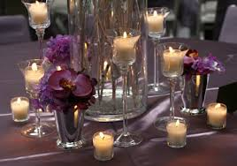 stemmed glass candle holders with votive candles