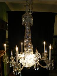 nineteenth century crystal chandelier in the manner of f c osler it has been entirely red professionally wired and the metal framework re silver