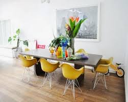 vibrant dining room setting with eiffel chairs