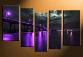 5 piece canvas wall art night life 5 piece canvas wall art shocking glowing light purple along bridge cloudy skies water reflection