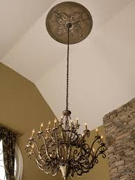 large faux finished ceiling medallion and wrought iron chandelier
