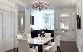 a chandelier is an excellent ceiling light for a dining room it works even in dining rooms with regular height ceilings because even though it hangs down