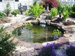 Lawn & Garden:Excelent Round Backyard Fish Pond Ideas With Stone Surround  Plus Artificial Waterfall