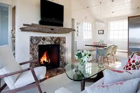 built in firewood storage living room beach style with stone fireplace built in booth driftwood