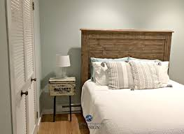 sherwin williams sea salt best green blue paint colour in guest bedroom with wood headboad rustic style kylie m e design