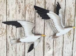 wooden seagulls wall art