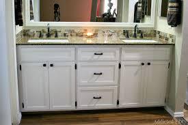 a white diy bathroom vanity installed in a bathroom addicted 2 diy