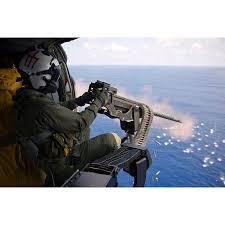 Naval Aircrewman Fires A 50 Caliber Machine Gun From A Mh 60s Knighthawk Poster Print By Stocktrek Images