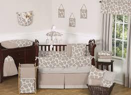 charming image of uni animal baby nursery decoration with cream giraffe baby bedding set including light