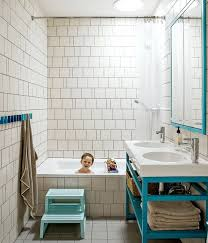 dwell bathroom ideas modern bathroom with irregular tiled wallthe two bowl sink is the vitviken model from ikea its topped with a chrome hansgrohe faucet and accented by