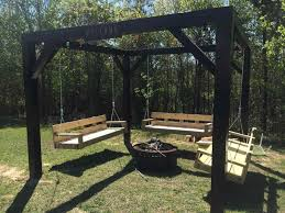 welcome invite your friends for a relaxing afternoon in your courtyard you can ting around the fire pit while swinging in generous wooden benches