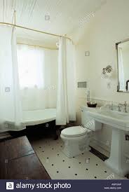 Traditional White Bathrooms White Shower Curtains On Freestanding Bath In Traditional White