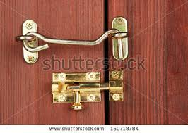 door latch hook. Metal Hook And Deadbolt In Wooden Door Close-up Latch O