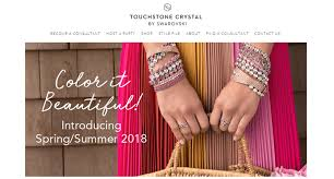 touchstone crystal screenshot showing a woman with many diffe pink and white bracelets and