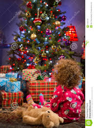 Little Girl Staring At Christmas Tree Vertical Stock Image Image