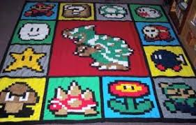 Mario Quilt - Mobile Venue & The Mario Quilt is designed by Crafster and has pixelated type icons of  Mario, Bowser and others sewn in to it. It looks 8-bit style and 1.5 inch  squares ... Adamdwight.com