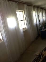 a creative way to hang curtainore barn photos