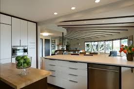 mid century modern kitchen lighting with wooden cabinets