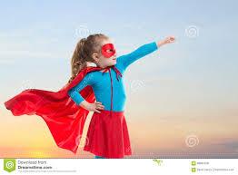 Little Child Girl Plays Superhero Child On The Background